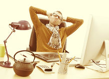 Exhausted entrepreneur with headache suffering from working late, vintage effects Royalty Free Stock Photo