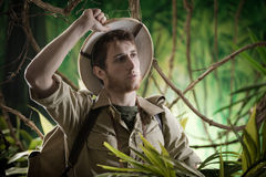 Exhausted explorer in the jungle Stock Photography