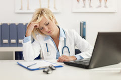 Exhausted female doctor Stock Photos