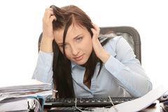 Exhausted female filling out tax forms Stock Photos
