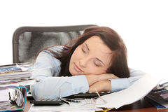 Exhausted female filling out tax forms Royalty Free Stock Image