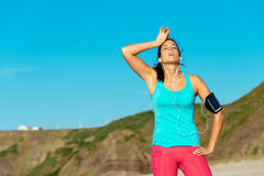 Exhausted female runner overtraining Stock Image