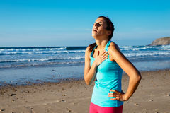 Exhausted female runner suffering angina pectoris Royalty Free Stock Images