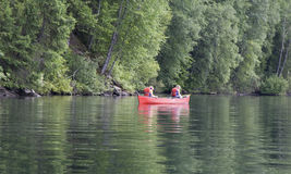 Exhausted girl and boy canoeing Stock Images