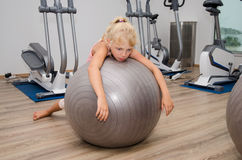 Exhausted girl in the gym Royalty Free Stock Photography