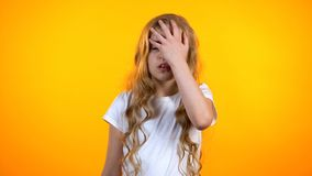 Exhausted girl making facepalm gesture, feeling lack of energy, avitaminosis royalty free stock images