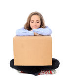 Exhausted girl with moving box Royalty Free Stock Images