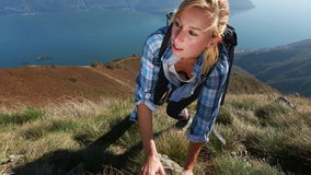 Exhausted hiker reaches top of mountain stock video
