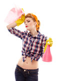 Exhausted housewife with hand on forehead Royalty Free Stock Photo