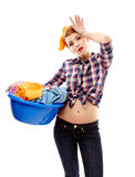 Exhausted housewife with the laundry basket. Studio shot of tired housewife holding the laundry basket, isolated over white background Stock Photography