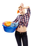 Exhausted housewife with the laundry basket Stock Images