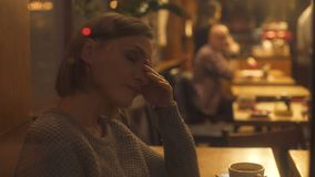 Exhausted lady resting in cafe, tired of hustle and bustle of big city, crisis stock video