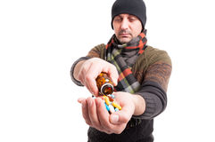 Exhausted male with flu taking medicines Royalty Free Stock Photo