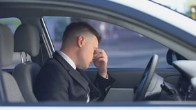 Exhausted male in formal suit sitting on driver seat, stressful life, overwork. Stock footage stock video