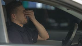 Exhausted male police officer taking off sunglasses and massaging nose, hard day stock video