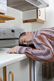 Exhausted man asleep in a frying pan. Sleep disorder concept - Exhausted man asleep in a frying pan Stock Photo