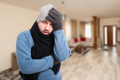 Exhausted man feeling bad and having headache Stock Images
