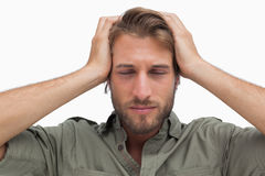 Exhausted man with hands on head Royalty Free Stock Photo
