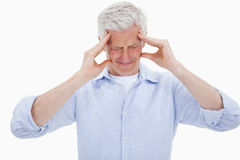 Exhausted man having a strong headache Royalty Free Stock Images