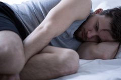 Exhausted man with insomnia Royalty Free Stock Image