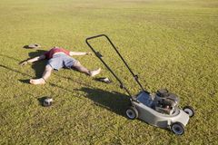 An Exhausted Lawn Mowing Man royalty free stock photo