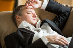 Exhausted man in office Stock Photography