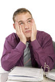 Exhausted man in office with documents Royalty Free Stock Image