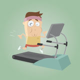 Exhausted man running on treadmill Royalty Free Stock Photo