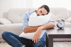 Exhausted man sleeping with head resting on pillow Royalty Free Stock Photo