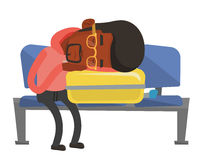 Exhausted man sleeping on suitcase at airport. Stock Images