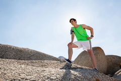 Exhausted man taking a break after jogging on beach Stock Photos