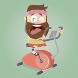 Exhausted man training on indoor bike trainer Stock Photography