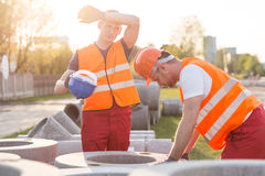 Exhausted manual workers Stock Image