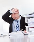 Exhausted Mature Businessman At Work Stock Image
