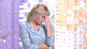 Exhausted mature woman, side view. Middle-aged business woman having headache. Stress and anxiety concept stock video