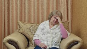 Exhausted Mature woman suffering from headache touching his temples. Feeling unhappy having a headache from stress. stock footage