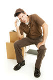 Exhausted Mover Takes a Break Royalty Free Stock Photography