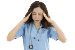 Exhausted nurse or doctor having a headache Royalty Free Stock Photo