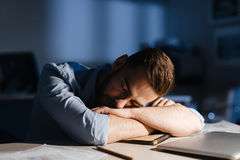 Exhausted Office Worker Falling Asleep at Desk Royalty Free Stock Images