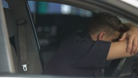 Exhausted policeman getting into car after stressful accident, hard work day. Stock footage stock video footage