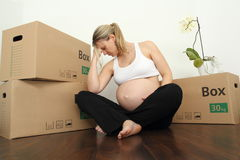 Exhausted Pregnant Moving with packing case Stock Photo