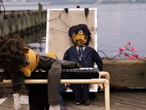Exhausted puppets. Intermission for a local busker and his puppets stock photography