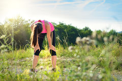 Exhausted runner catching her breath Royalty Free Stock Photos