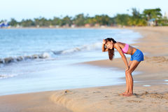 Exhausted Runner Relaxing On Beach After Running Stock Images