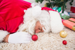 Exhausted santa resting on the rug Stock Photo
