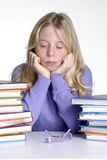 Exhausted school girl portrait with books. Stock Photo