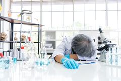 Free Exhausted Scientist Sleeping In Laboratory. People Lifestyles And Occupation Concept. Science And Experiment In Lab Theme Stock Photos - 153530663