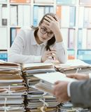 Exhausted secretary overloaded with work royalty free stock photos