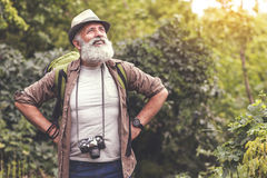 Exhausted senior male tourist resting after walking Royalty Free Stock Photo
