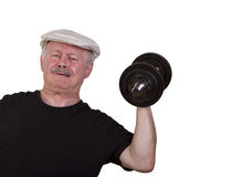 Exhausted senior man lifting dumbbell Royalty Free Stock Images